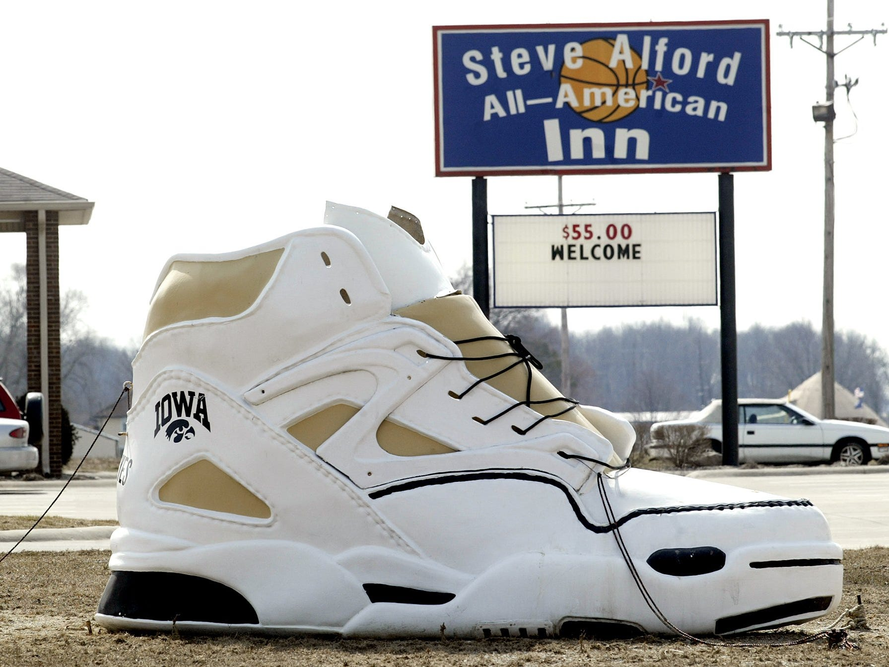 From 2005: Steve Alford's still a hero to most folks in his hometown of New Castle, Indiana, where this fiberglass replica of an Iowa Hawkeye sneaker sits in front of Alford's All-American Inn.