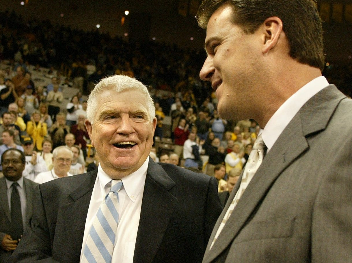 From 2003: Drake coach Tom Davis, left, shakes hands with Iowa coach Steve Alford after the Hawkeyes beat the Bulldogs, 74-56.