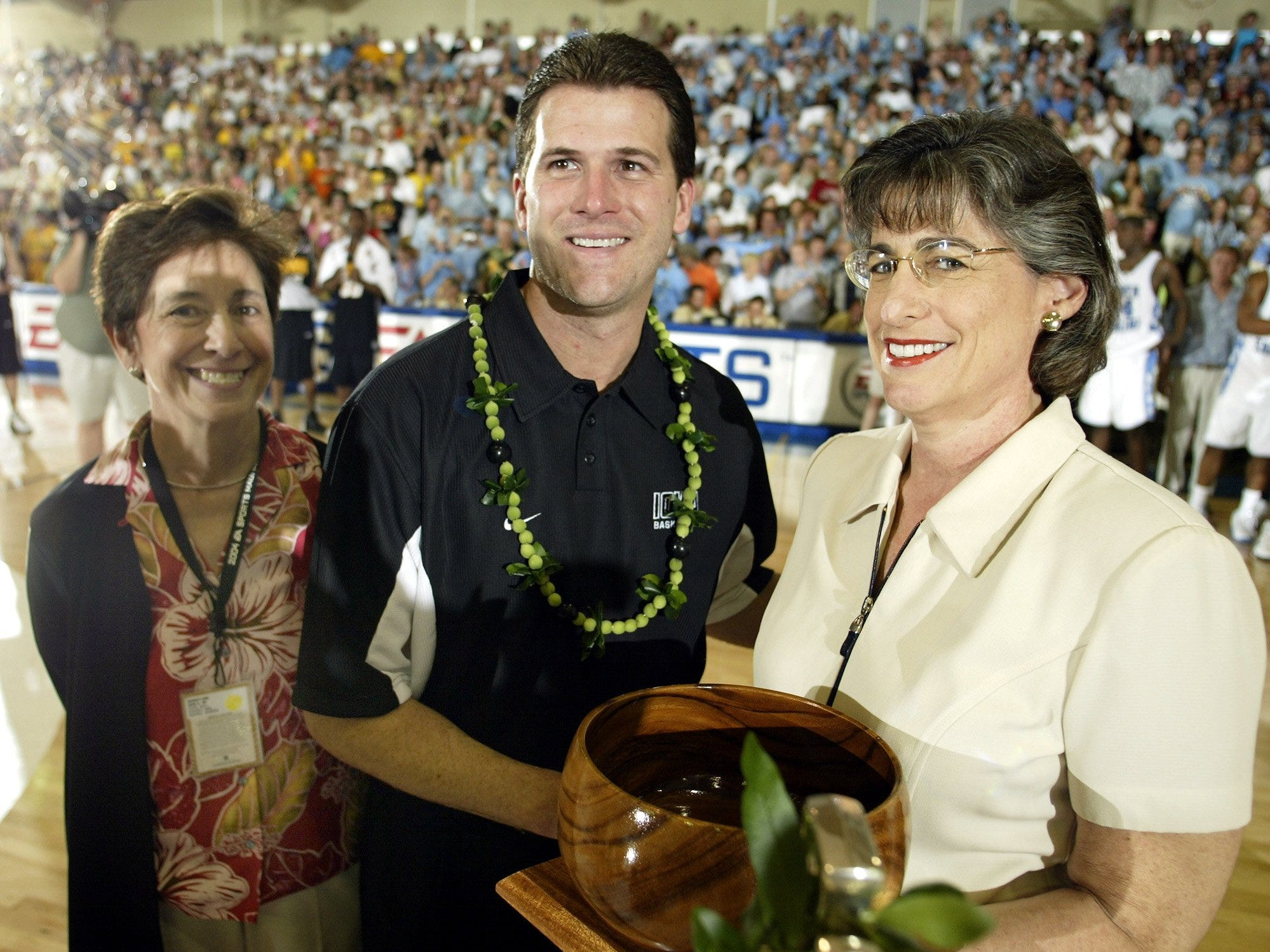 From 2004: Iowa coach Steve Alford receives the runner-up trophy from Hawaii Gov. Linda Lingle, right, after the Hawkeyes lost to North Carolina, 106-92, at the Maui Invitational.