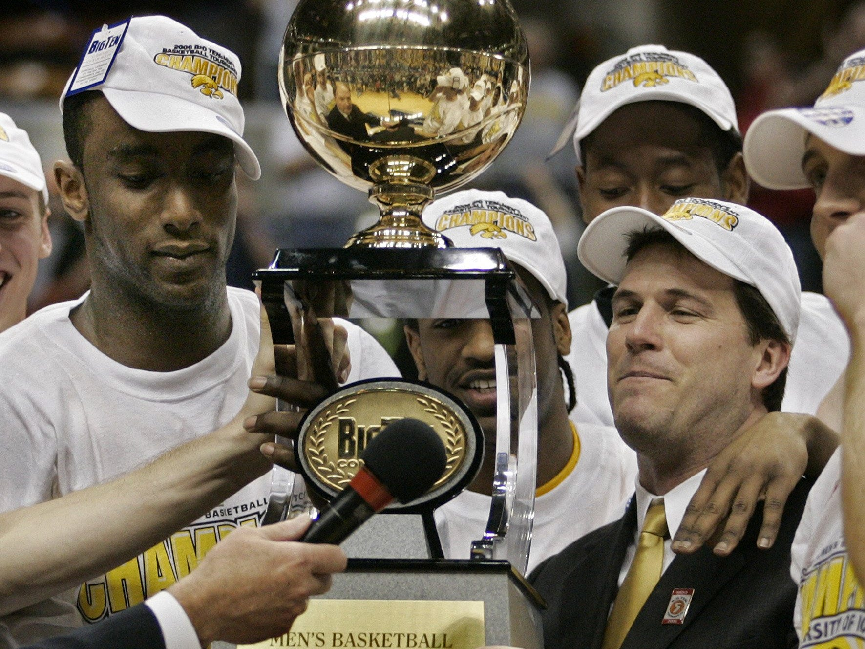 From 2006: Iowa forward Doug Thomas and coach Steve Alford keep a close watch on the Big Ten Conference tournament trophy after the second-seeded Hawkeyes topped No. 1 seed Ohio State 67-60 in Indianapolis, Ind.