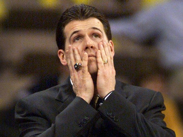 From 2003: Iowa Hawkeyes basketball coach Steve Alford looks at the scoreboard during the first half of their 62-60 win in the opening game of the NIT.