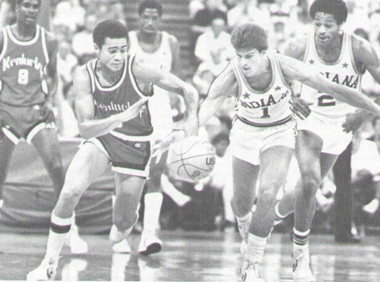 Kentucky's Terry Stewart grabs Indiana Mr. Basketball Steve Alford #1 to slow a fast break.  James Blackmon #2 and Kentucky's Vincent Sandford #8 are in the background.