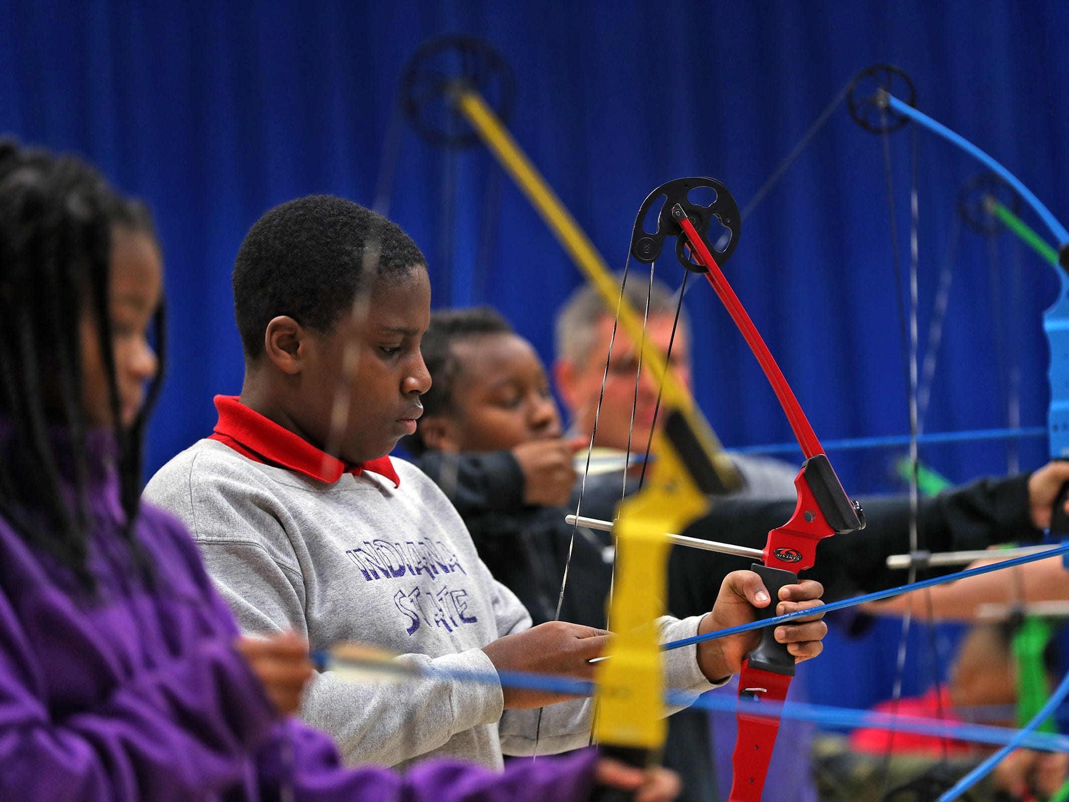Sixth graders prepare to take aim, during archery class at Lew Wallace Elementary IPS 107, Thursday, Dec. 20, 2018.
