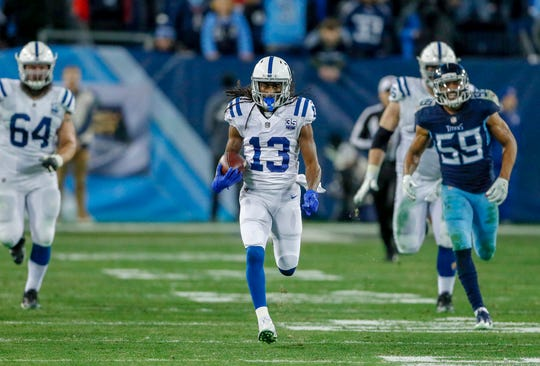 Indianapolis Colts wide receiver T.Y. Hilton (13) takes a pass downfield against the Tennessee Titans at Nissan Stadium in Nashville, Tenn., on Sunday, Dec. 23, 2018.