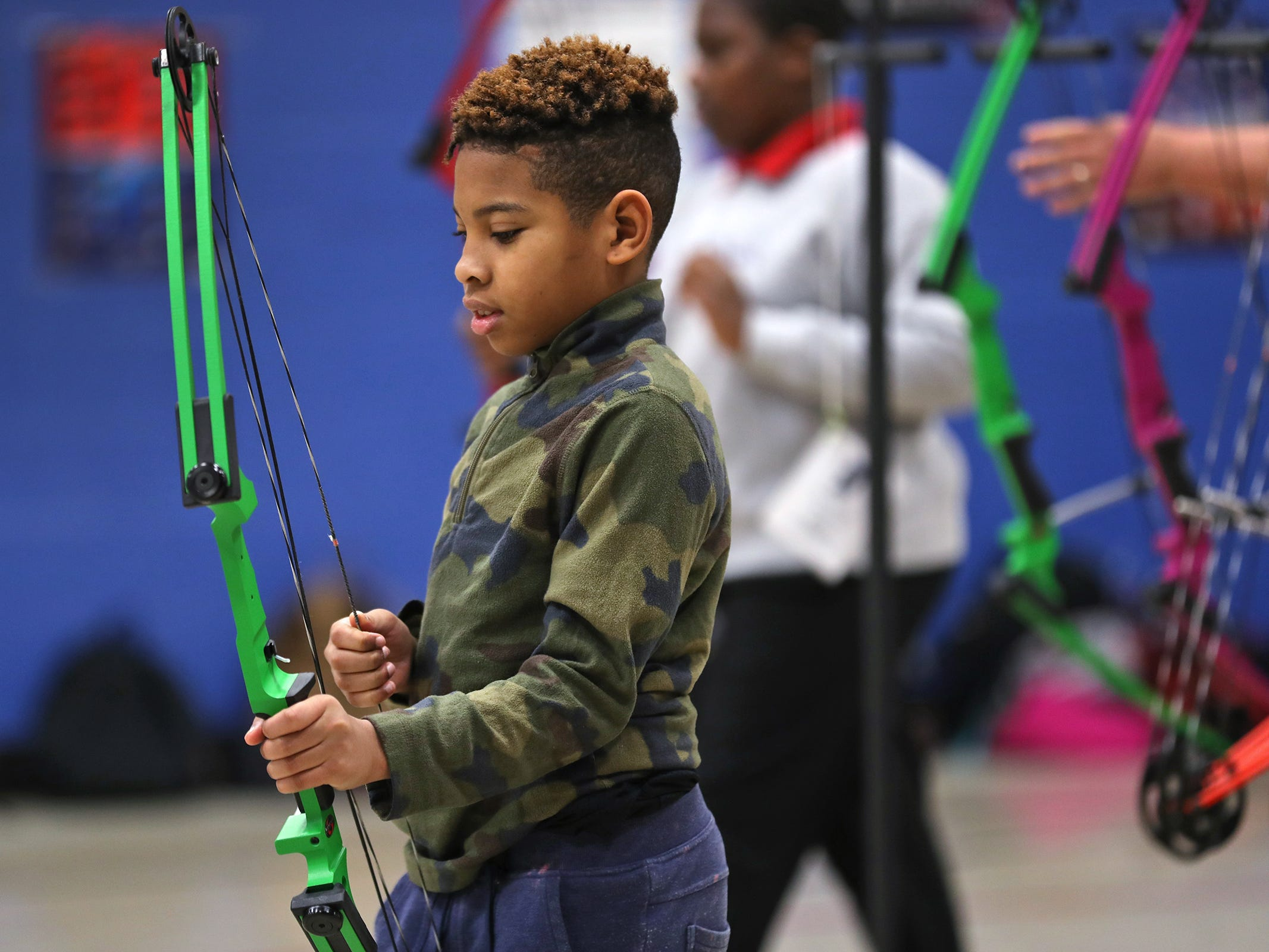 Courtney Washington gets his bow ready before shooting, during archery class at Lew Wallace Elementary IPS 107, Thursday, Dec. 20, 2018.