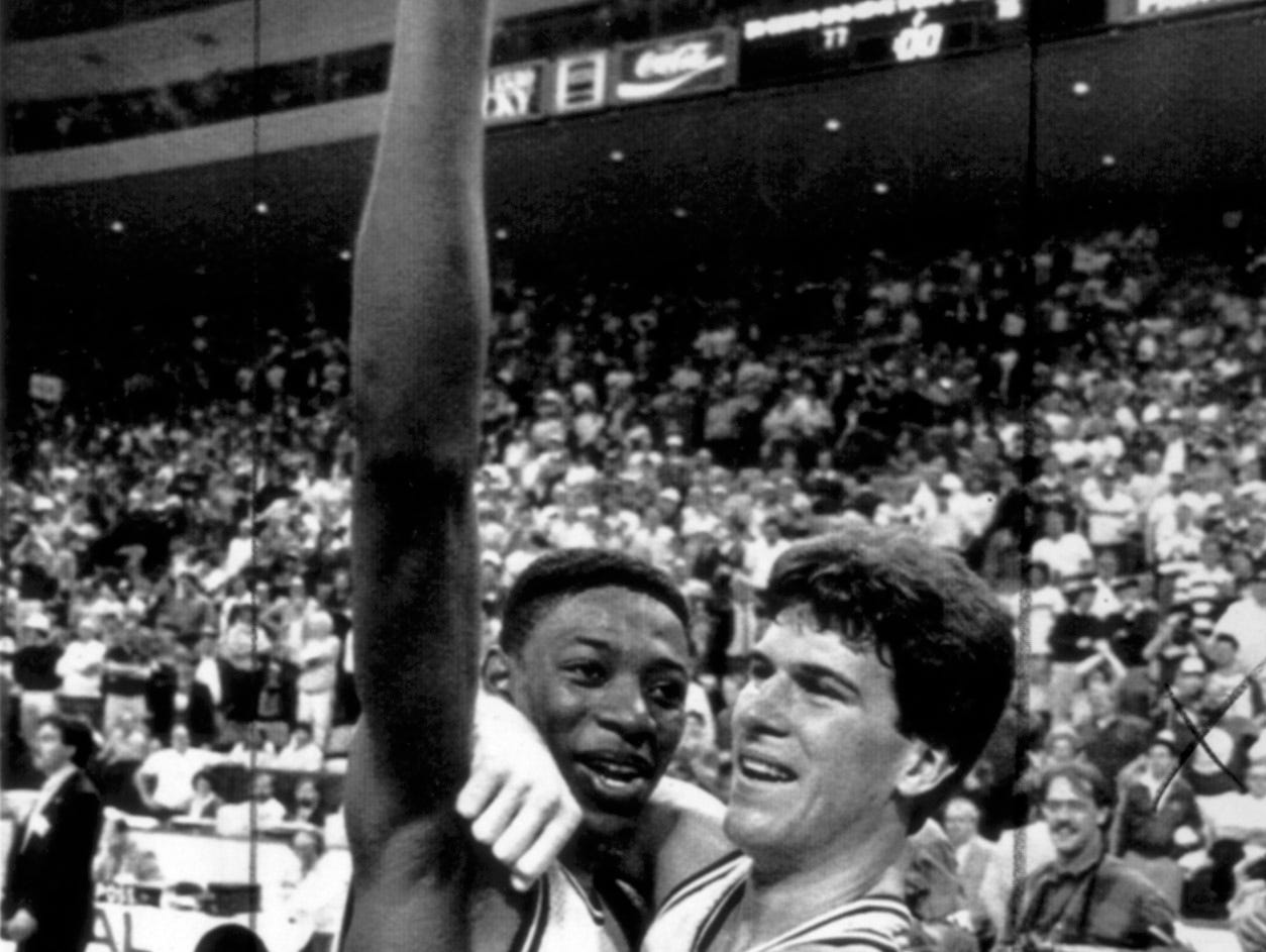 3/23/87  --  Hoosiers Keith Smart and Steve Alford celebrate their win following Smart's last minute shot to win the NCAA Championship in New Orleans.