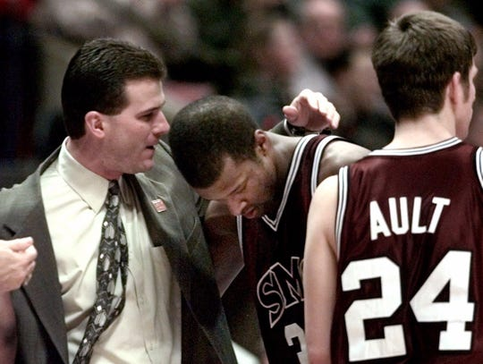 March 19, 1999: Southwest Missouri State coach Steve Alford, left, consoles Allen Phillips after their East Regional Semifinal game against Duke in East Rutherford, N.J.  Duke defeated the Bears 78-61.