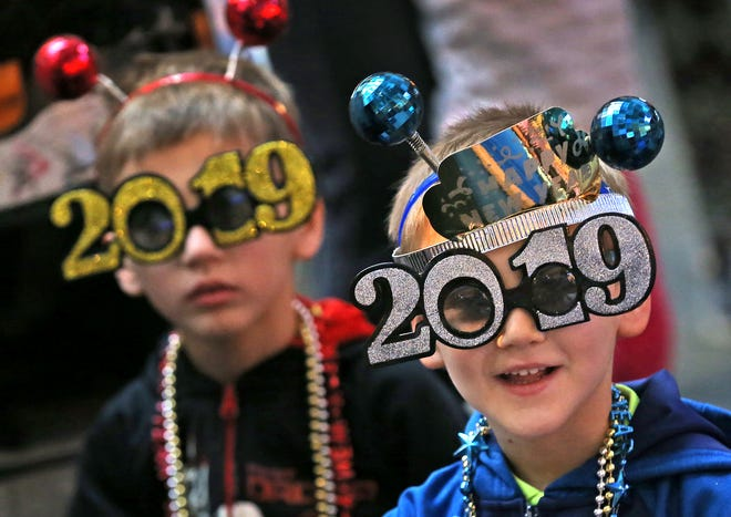 Noah and William Walker ready themselves for the new year at the Countdown to noon celebration at the Children's Museum of Indianapolis, Monday, Dec. 31, 2018.