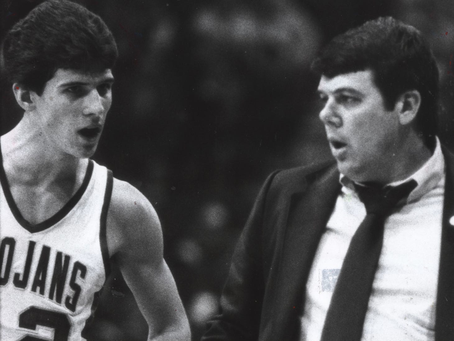 New Castle's Steve Alford talks to his coach and father, Sam Alford, during the Trojans' 79-64 victory over Broad Ripple in the 1983 state high school playoffs at Hinkle Fieldhouse. Alford scored 57 points in the game.