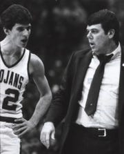 1983: New Castle's Steve Alford talks to his coach and father, Sam Alford, during the Trojans' 79-64 victory over Broad Ripple in the 1983 state high school playoffs at Hinkle Fieldhouse. Alford scored 57 points in the game.
