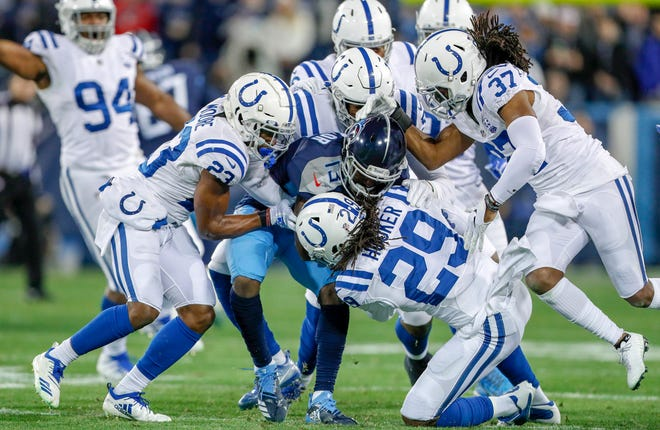 The Indianapolis Colts defense wraps up Tennessee Titans wide receiver Taywan Taylor (13) at Nissan Stadium in Nashville, Tenn., on Sunday, Dec. 23, 2018.