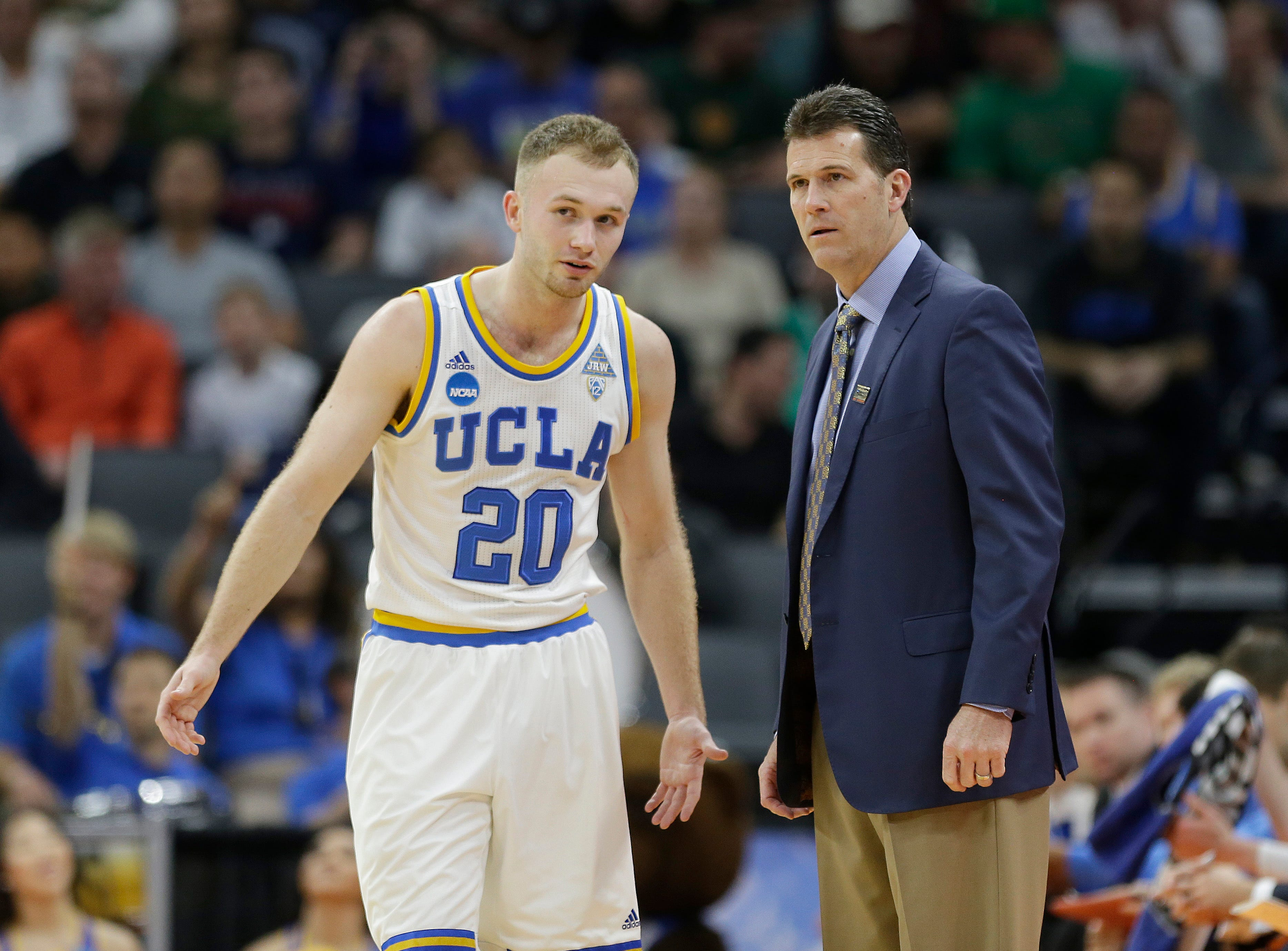 UCLA coach Steve Alford talks with his son, guard Bryce Alford, during the first half of a first-round game against Kent State in the men's NCAA college basketball tournament in Sacramento, Calif., Friday, March 17, 2017. (AP Photo/Rich Pedroncelli)