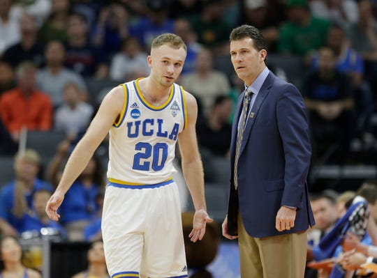 Then UCLA coach Steve Alford spoke with his son, guard Bryce Alford, during a first-round game against Kent State in the men's NCAA college basketball tournament in Sacramento, Calif., on March 17, 2017.