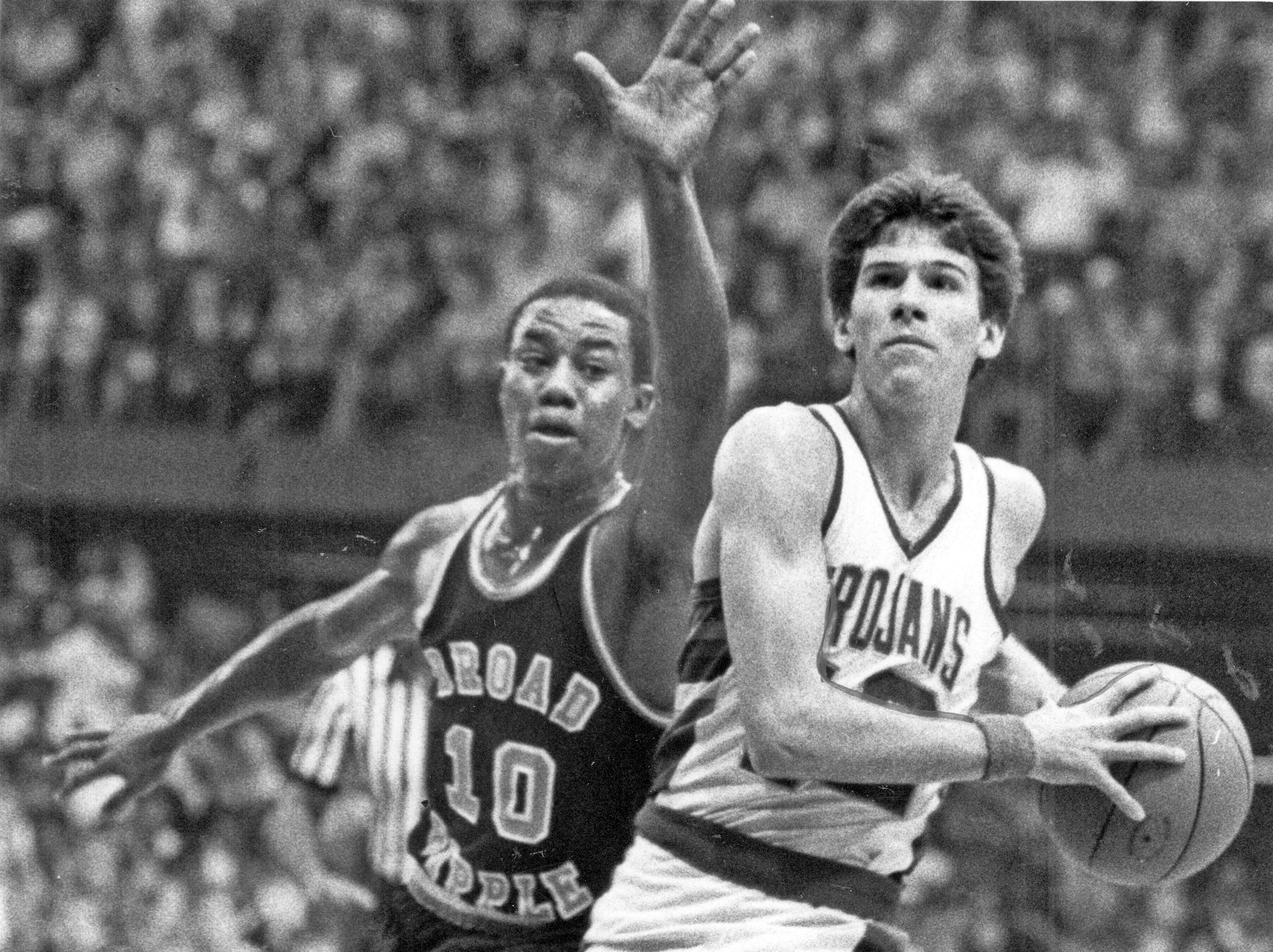 Steve Alford (right) of New Castle steals the ball from Broad Ripple's Donnie Harris on his way in for a layup, March 21, 1983.