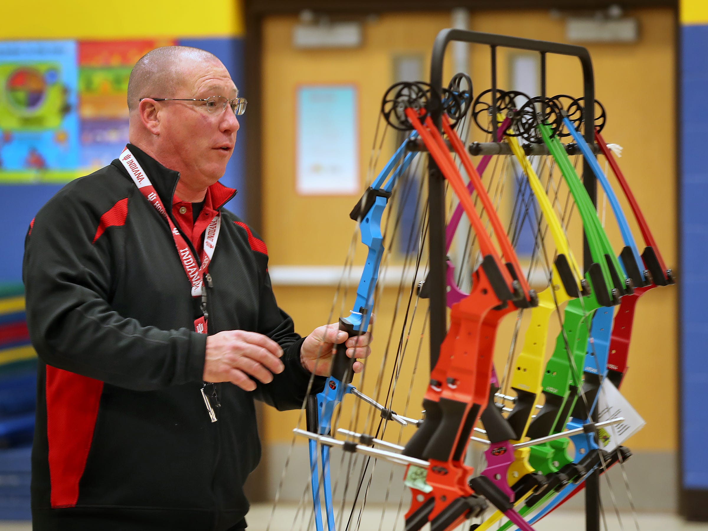 William Crawford gives safety tips to students before they shoot during archery class at Lew Wallace Elementary IPS 107, Thursday, Dec. 20, 2018.