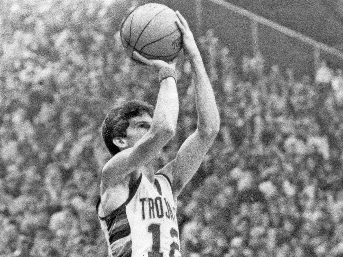 Dennis Bland of Broad Ripple watches New Castle's Steve Alford shoot in their March 19, 1983 semistate matchup at Hinkle Fieldhouse. Alford piled up 57 points and broke seven scoring recods in leading his team to a a 79-64 win over Broad Ripple. Alford hit 16 or 27 field goals and 25 consecutive free throws in the matchup. New Castle lost the semistate championship game to to the eventual state champs Connersville that evening 70-57, despite Alford's 37 points.