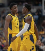 "Victor Oladipo (left) and Darren Collison speak after an Atlanta foul on Dec. 31, 2018 at Bankers Life Fieldhouse. About policing, Oladipo says: ""On the teams I've been on that are really good, we've been able to talk to each other, get on one another and no one takes it personal."""