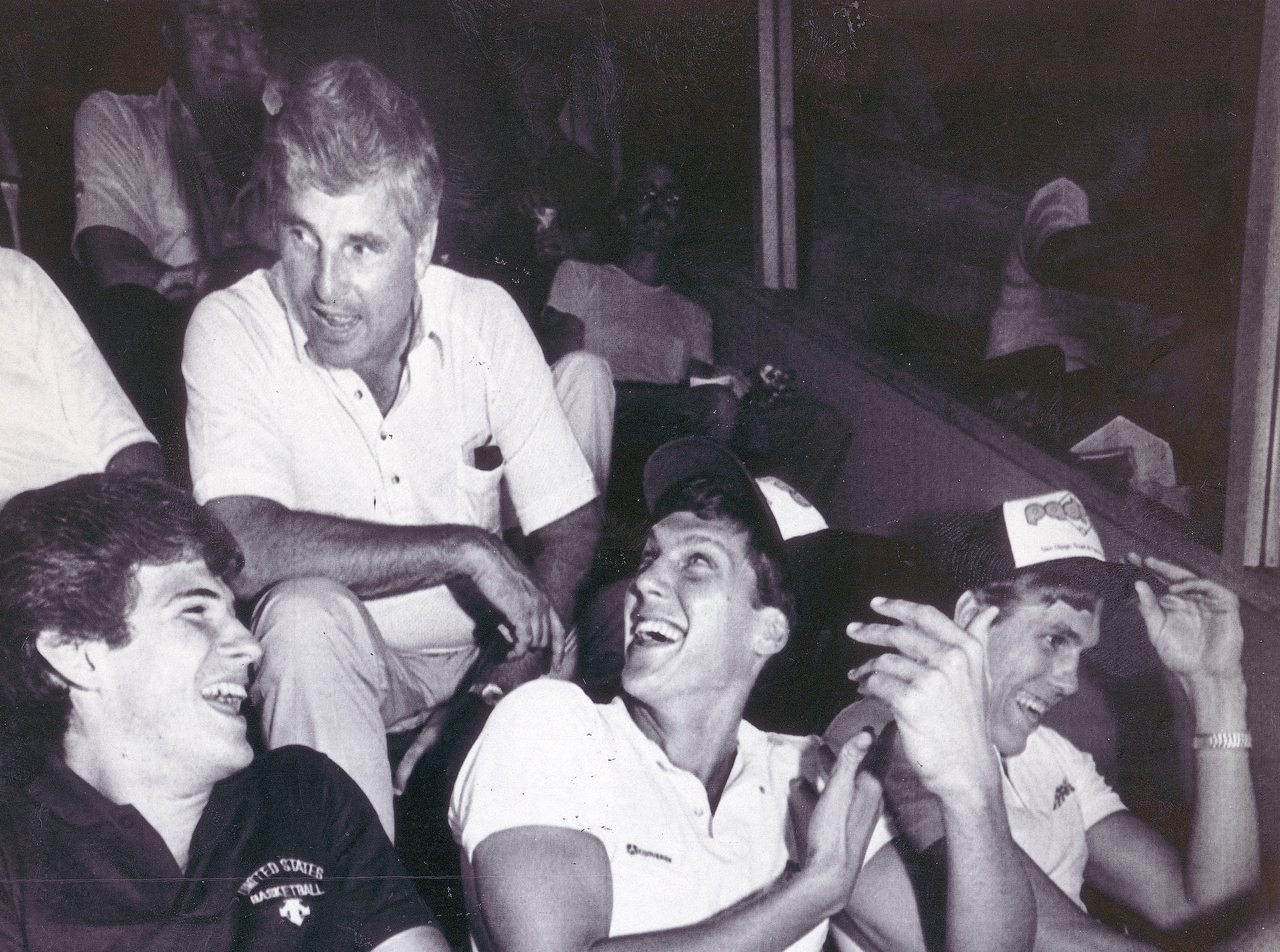 Olympic basketball coach Bob Knight (back) jokes with team members (from left) Steve Alford, Jeff turner and Jon Koncak.  July 24, 1984