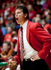 New Mexico coach Steve Alford yells to his players during the first half of an NCAA college basketball game against New Mexico State, Saturday, Dec. 5, 2009, in Albuquerque, N.M.