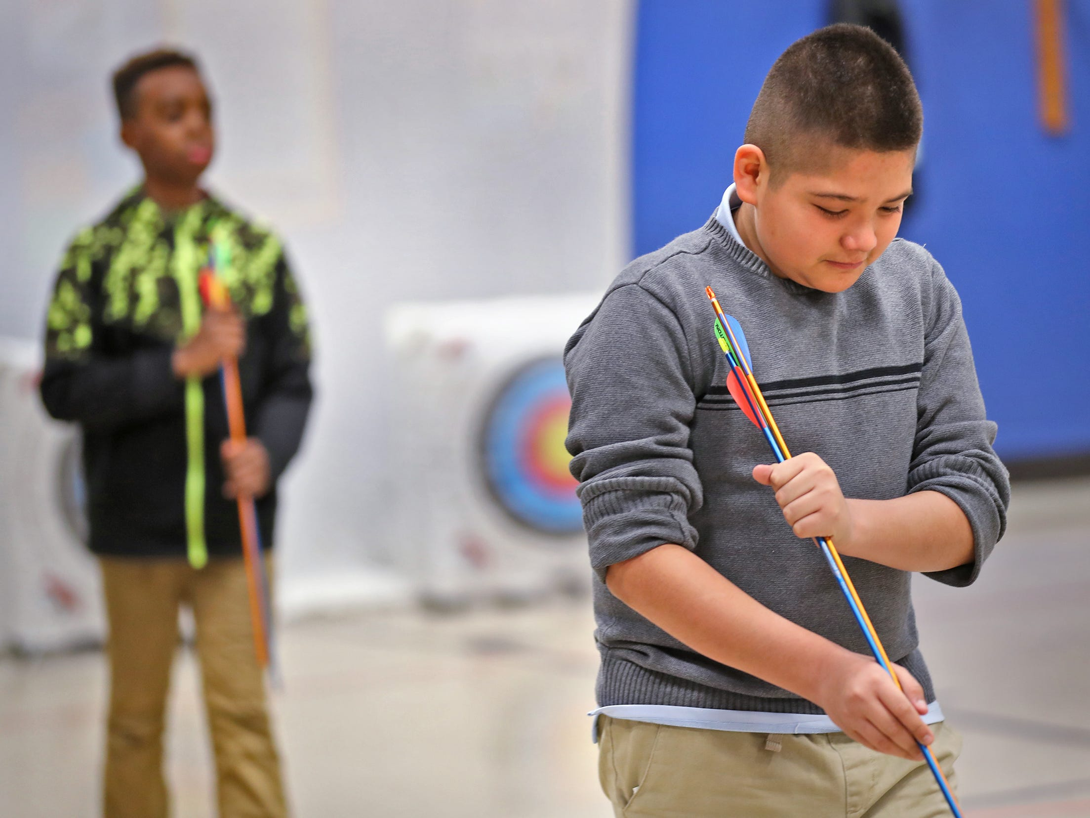 Francisco Barraza holds his arrows appropriately after retrieving them, during archery class at Lew Wallace Elementary IPS 107, Thursday, Dec. 20, 2018.