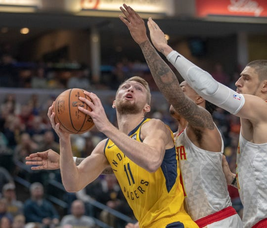 Domantas Sabonis of the Indiana Pacers is defended by Atlanta players at Bankers Life Fieldhouse, Indianapolis, Tuesday, Dec. 31, 2018. Indiana beat Atlanta 116-108.
