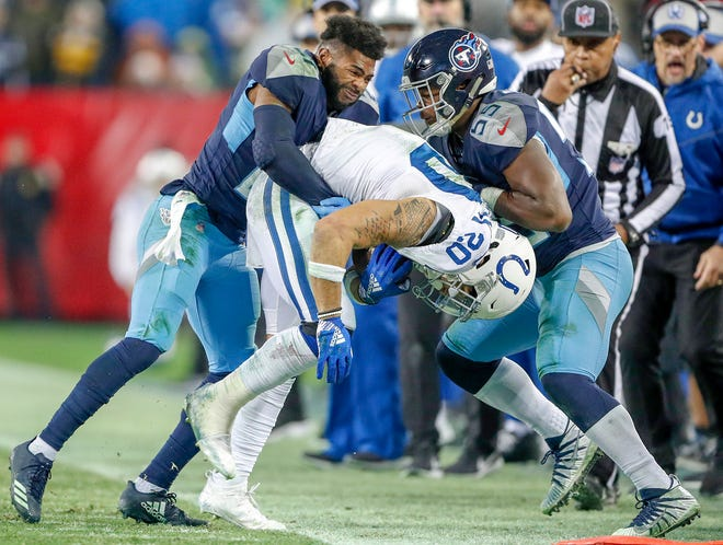 Indianapolis Colts running back Jordan Wilkins (20) is dragged out of bounds by the Tennessee Titans at Nissan Stadium in Nashville, Tenn., on Sunday, Dec. 23, 2018.