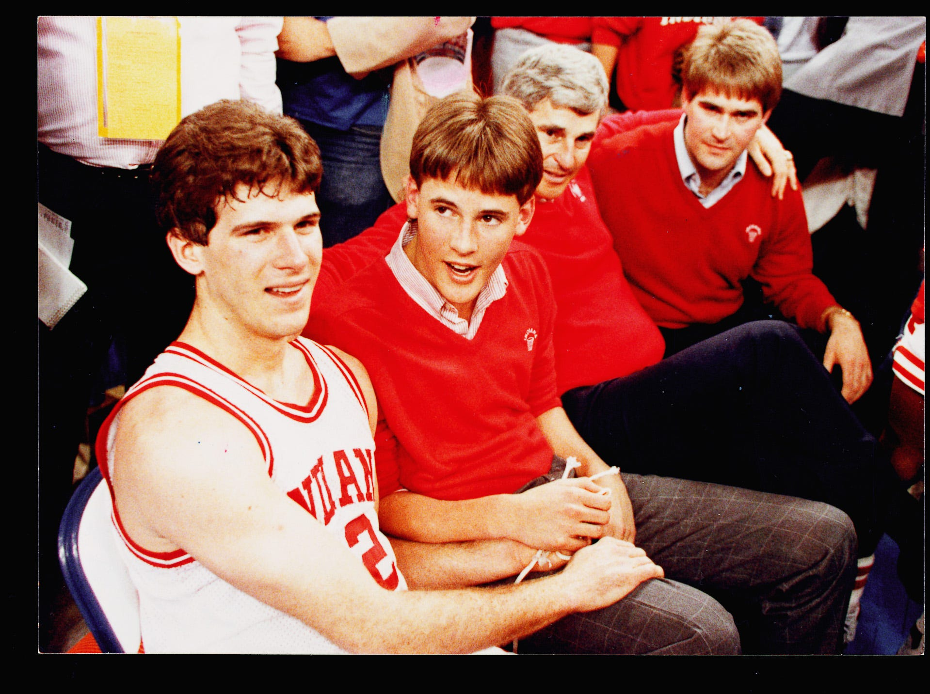 -- Indiana University basketball coach Bobby Knight celebrates National championship in 1987 with Steve Alford (left) and sons Pat and Tim (right).
