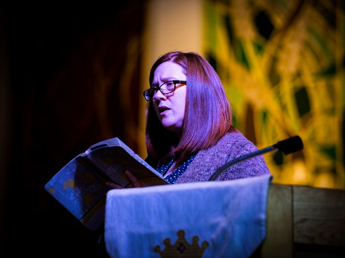 Jeannine Brown reads from the Bible during The WordPlayers' annual reading of Scripture at Erin Presbyterian Church in Knoxville on Monday, December 31, 2018.