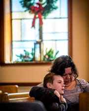 Churchgoers quietly listen as the Bible is read aloud during The WordPlayers' annual reading of Scripture at Erin Presbyterian Church in Knoxville on Monday, December 31, 2018.