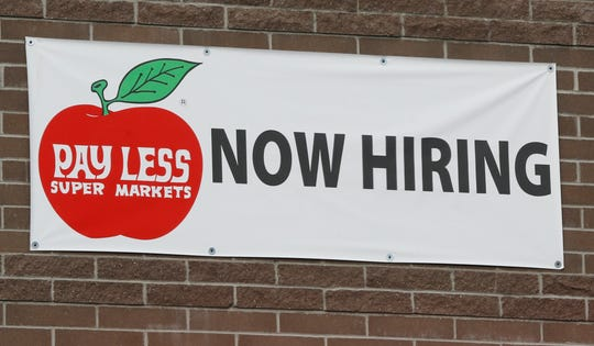 Now Hiring sign posted at Pay Less Super Market Wednesday, November 14, 2018, at 1032 Sagamore Parkway West in West Lafayette.