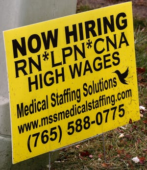 Now Hiring sign posted on Concord Road for Medical Staffing Solutions Wednesday, November 14, 2018, in Lafayette.