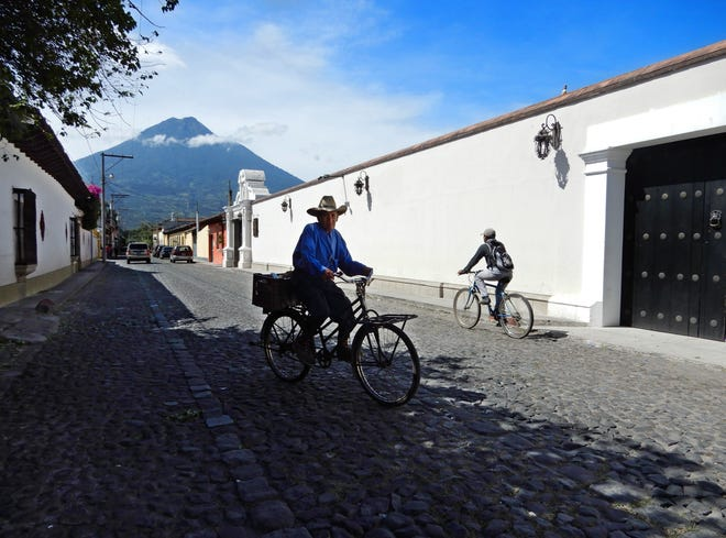 This is a street scene in Antigua, Guatemala that I photographed this past October. Antigua is beautiful, old city that has been ravaged by earthquakes several times in its history. In the background is Agua Volcano.