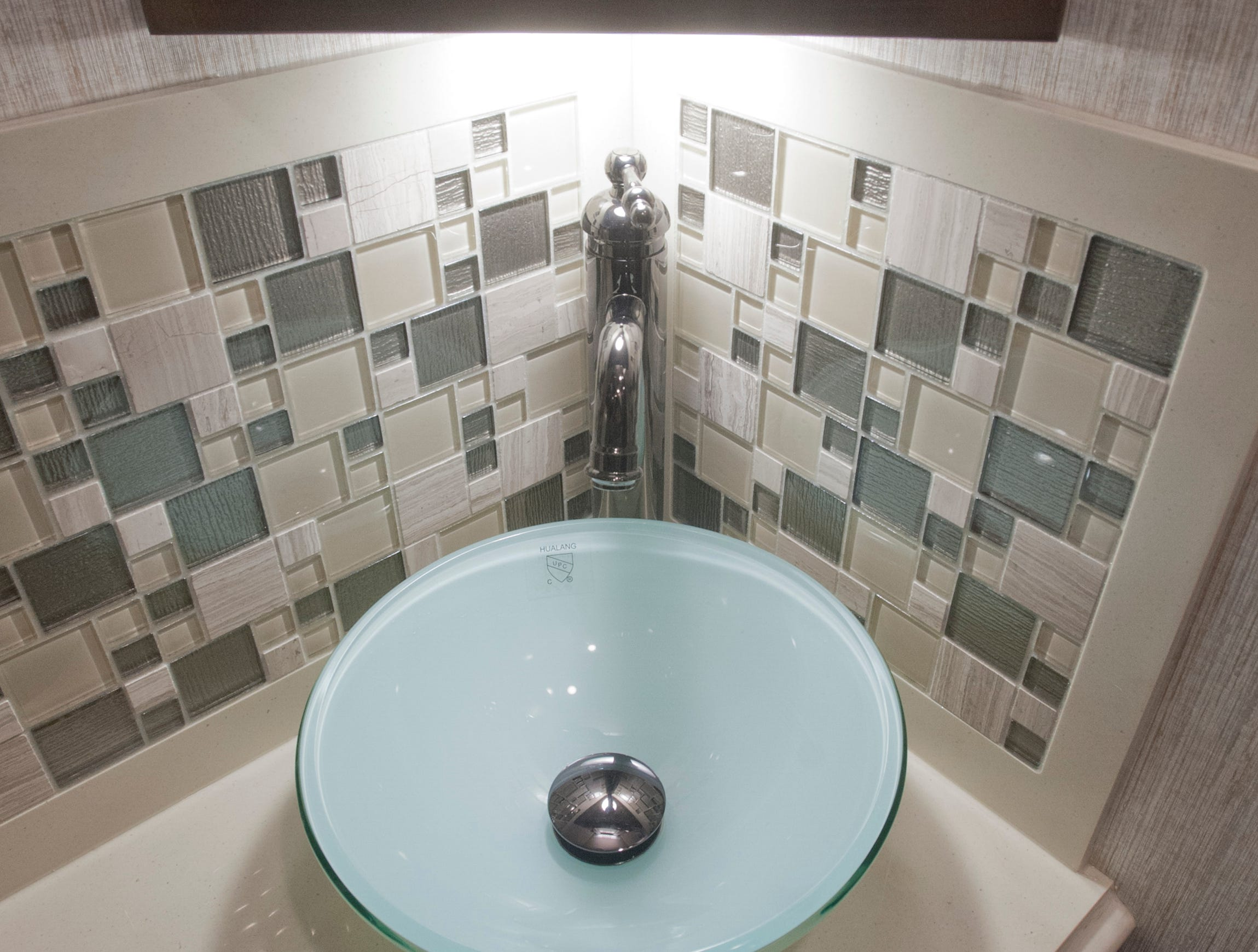 The half-bath includes this glass bowl sink.11 December 2018