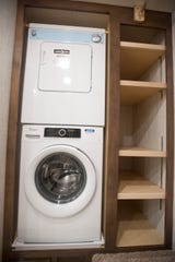 The master suite's closet includes a stacked washer-dryer.
