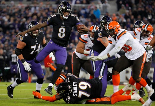01c553170ec Baltimore Ravens quarterback Lamar Jackson (8) rushes for a touchdown in  the first half