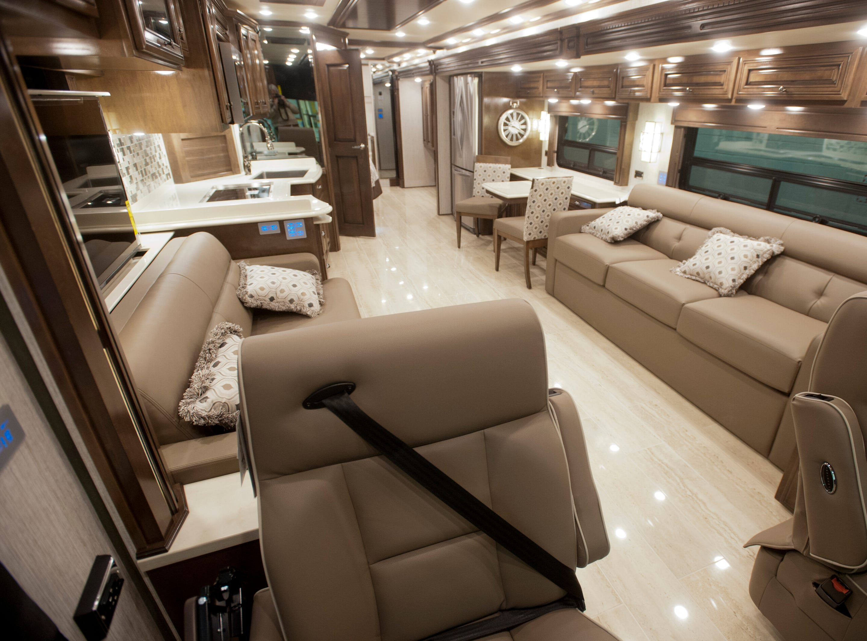 View of the cabin of the Dutch Star from the front passenger seat of the vehicle. The living room includes two couches that convert to beds, a kitchen with an induction stove top, a combination convection and microwave oven, and a steel double-sink. An eating area may be pulled out of the cabinet area in the kitchen, and from a table opposite the kitchen.11 December 2018
