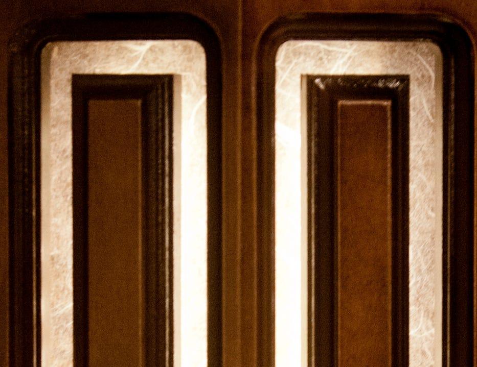 Backlit lights shine through woodwork inside the cabin.11 December 2018