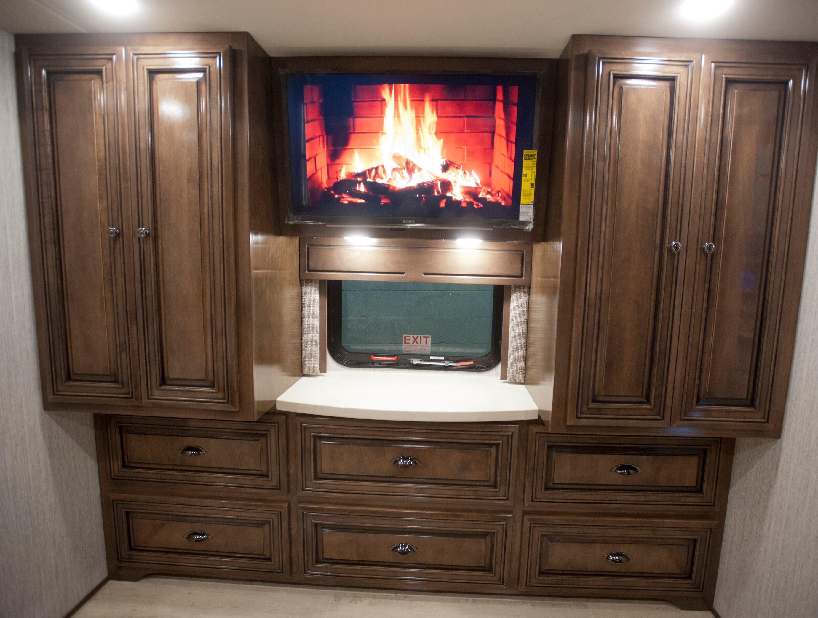 Cabinetry opposite the kingsize bed in the master bedroom includes a built-in television (seen here playing a video of a burning fireplace.)11 December 2018
