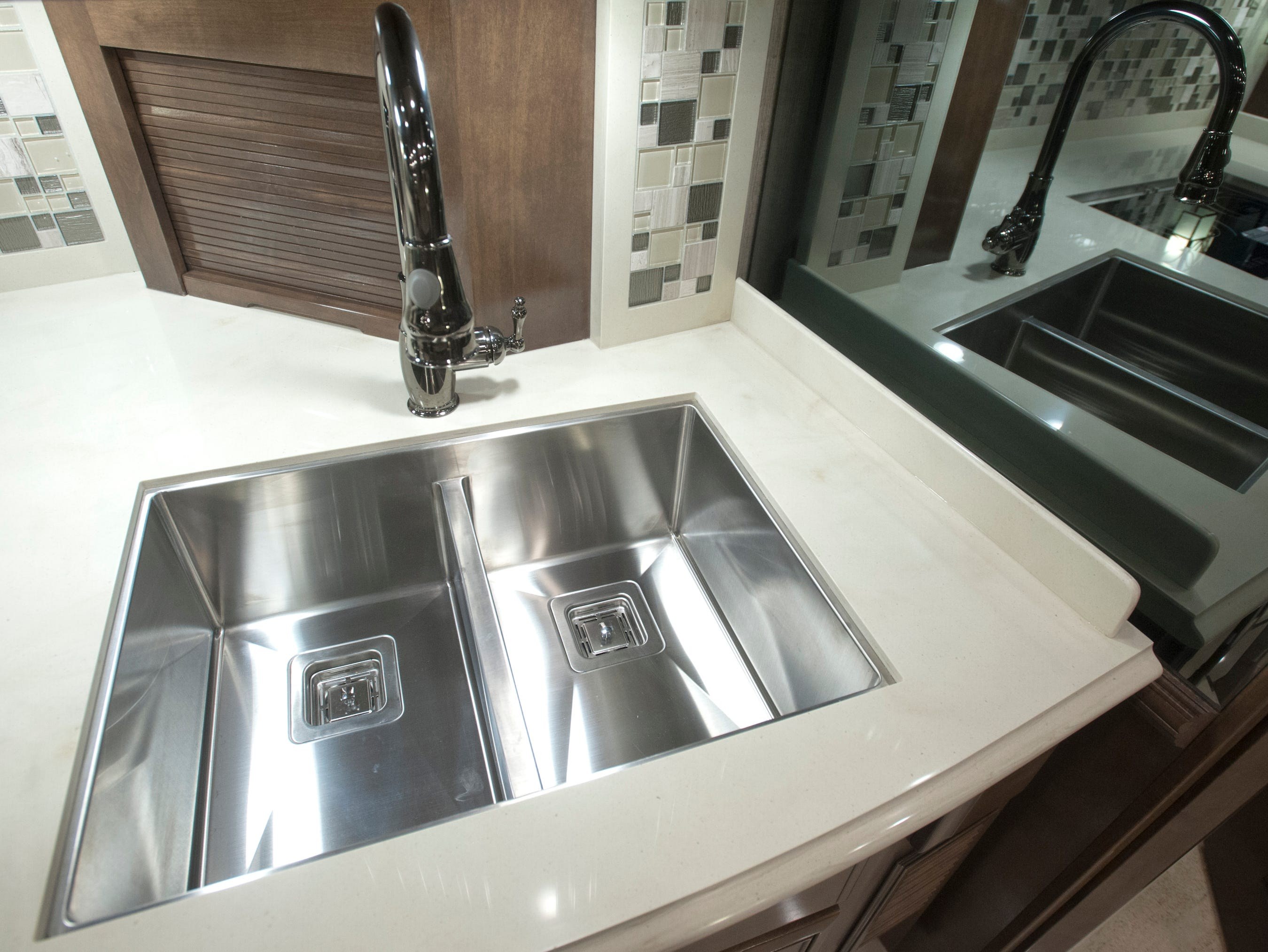The steel double-sink in the kitchen (which i also reflected in a mirror at right.)11 December 2018