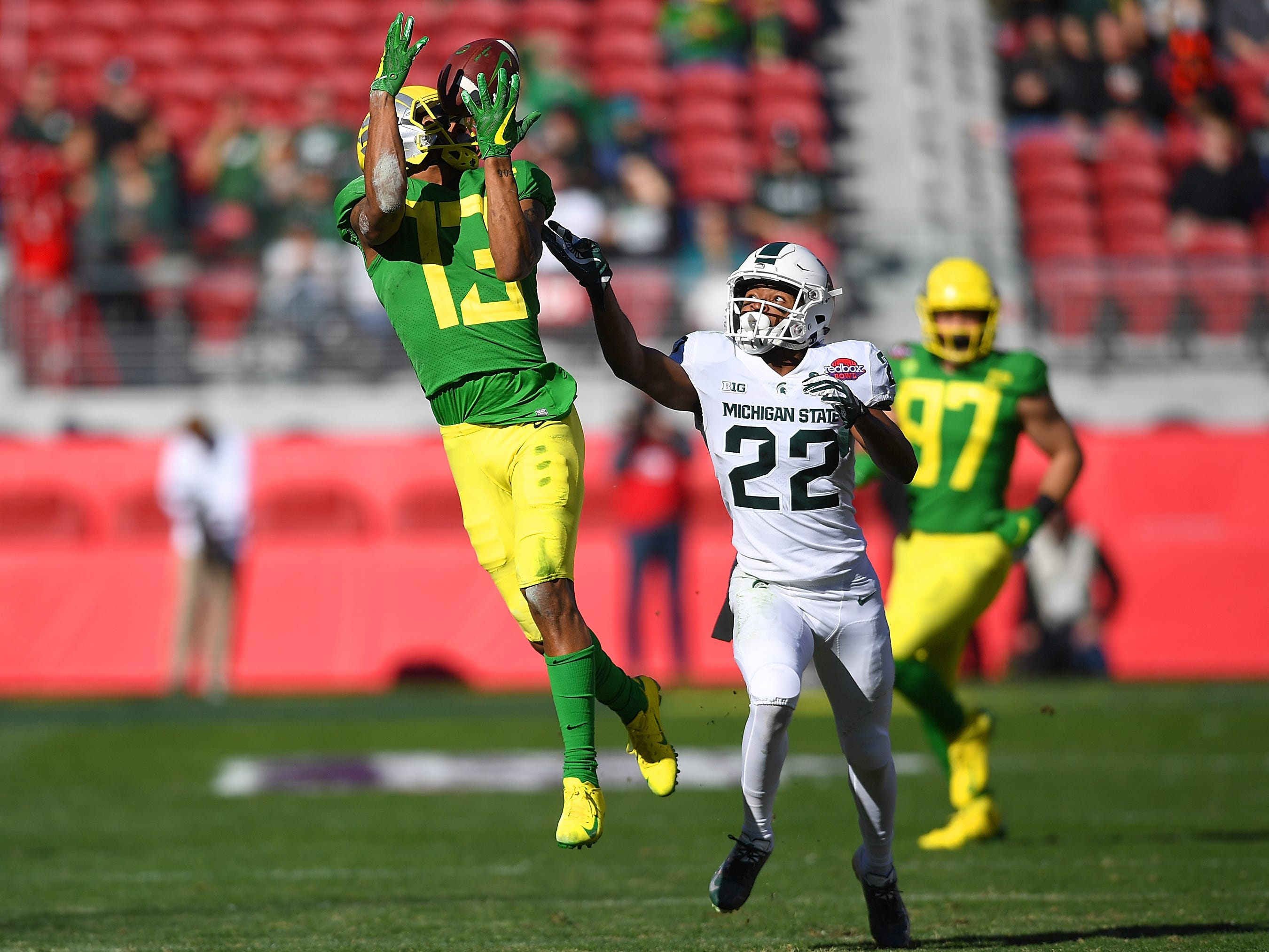 Dillon Mitchell #13 of the Oregon Ducks watches the ball bounce off his hands for an incomplete pass against the Michigan State Spartans during the first half of the Redbox Bowl at Levi's Stadium on December 31, 2018 in Santa Clara, California.