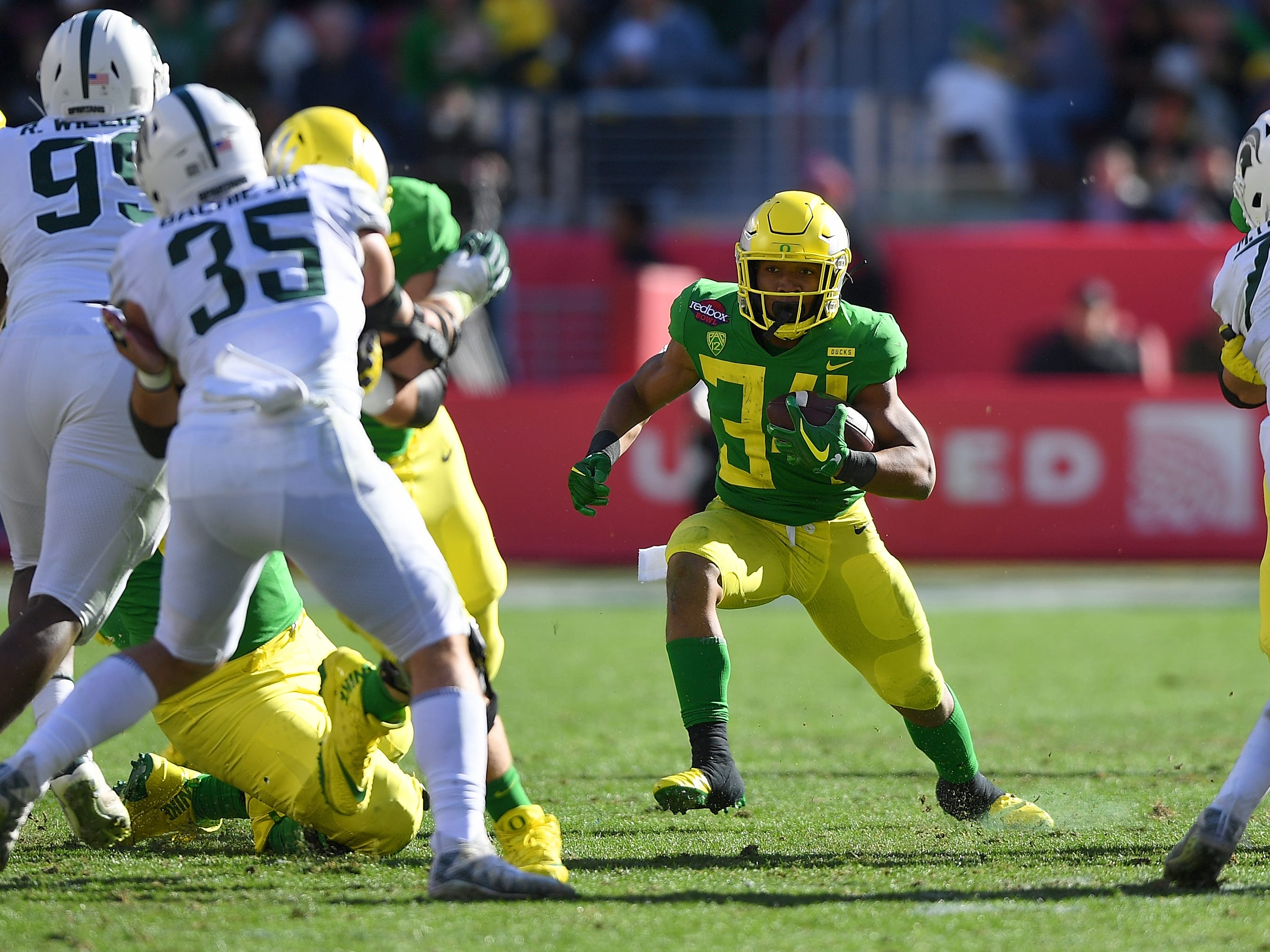 CJ Verdell #34 of the Oregon Ducks carries the ball against the Michigan State Spartans during the first half of the Redbox Bowl at Levi's Stadium on December 31, 2018 in Santa Clara, California.