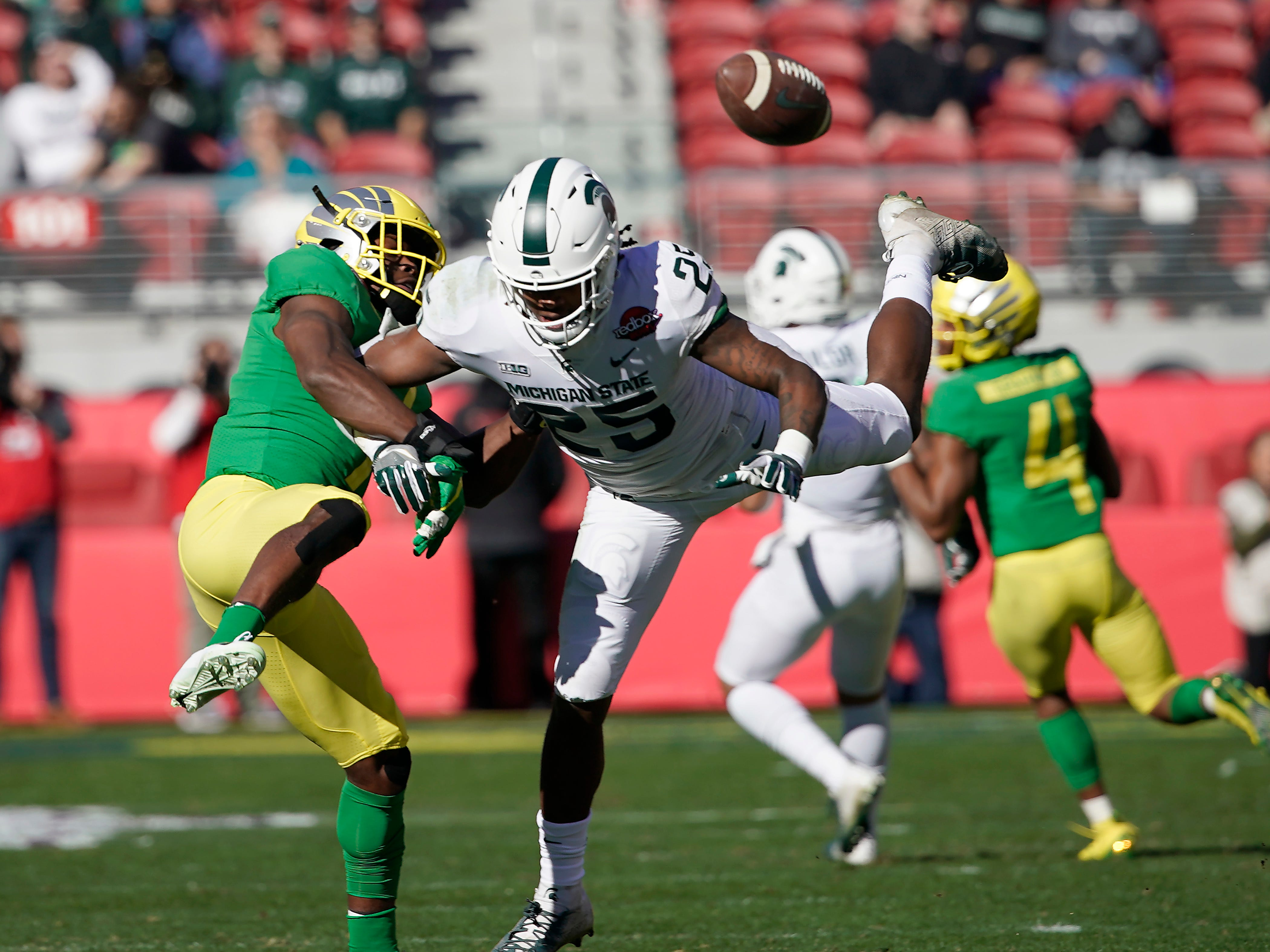 Oregon Ducks safety Ugochukwu Amadi (7) breaks up a pass for Michigan State Spartans wide receiver Darrell Stewart Jr. (25) during the first half of the Redbox Bowl NCAA college football game Monday, Dec. 31, 2018, in Santa Clara, Calif.
