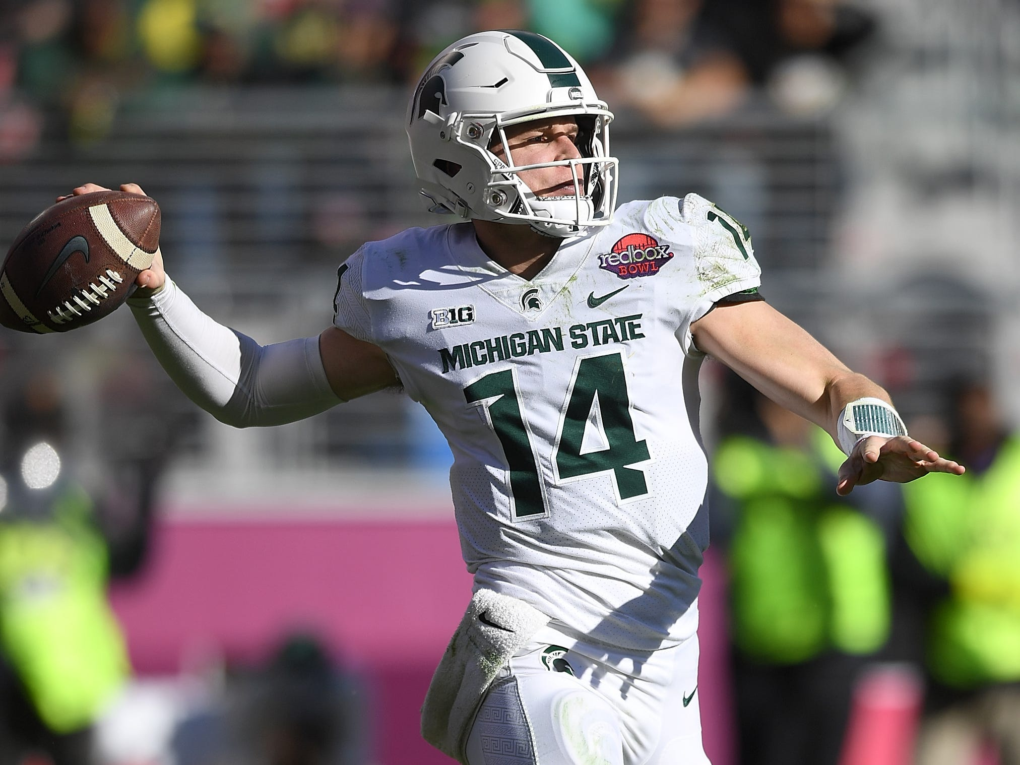 Brian Lewerke #14 of the Michigan State Spartans looks to pass against the Oregon Ducks during the first half of the Redbox Bowl at Levi's Stadium on December 31, 2018 in Santa Clara, California.