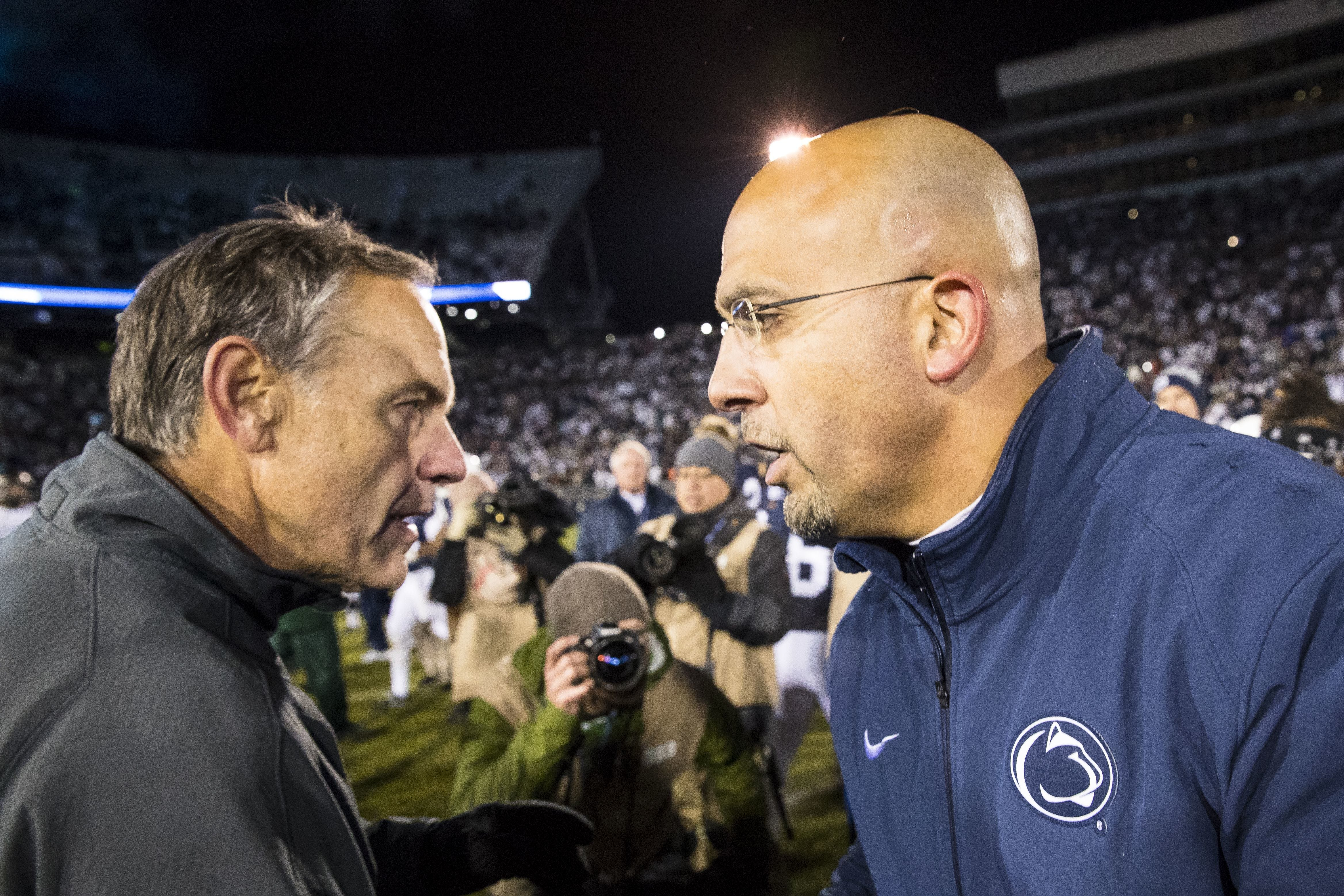 Michigan State football coach Mark Dantonio, left, and Penn State's James Franklin will meet again Oct. 26 at Spartan Stadium. The Spartans have won five of the last six meetings against the Nittany Lions.