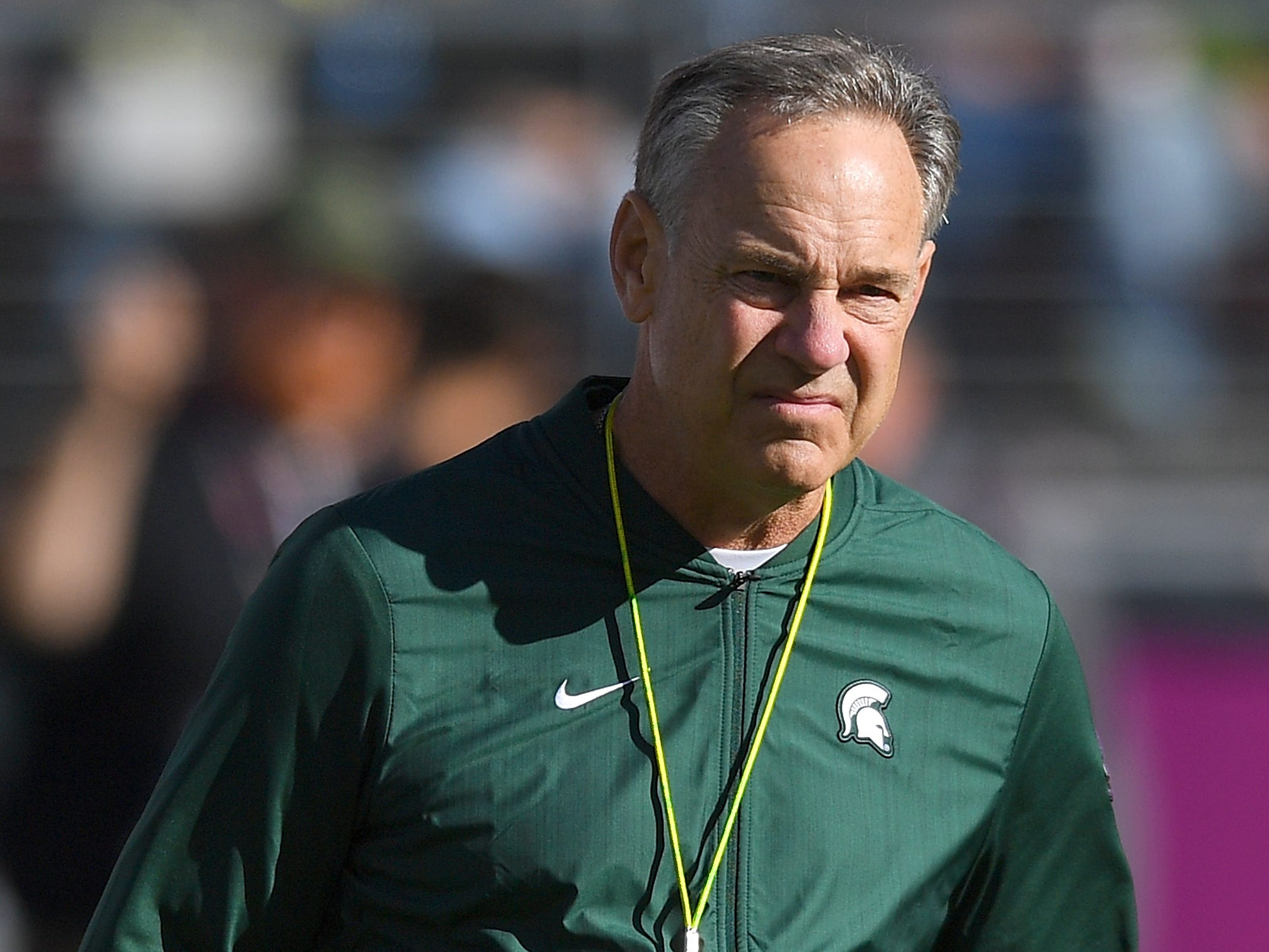 Head coach Mark Dantonio of the Michigan State Spartans looks on while his team warms up prior to the start of the Redbox Bowl against the Oregon Ducks at Levi's Stadium on December 31, 2018 in Santa Clara, California.