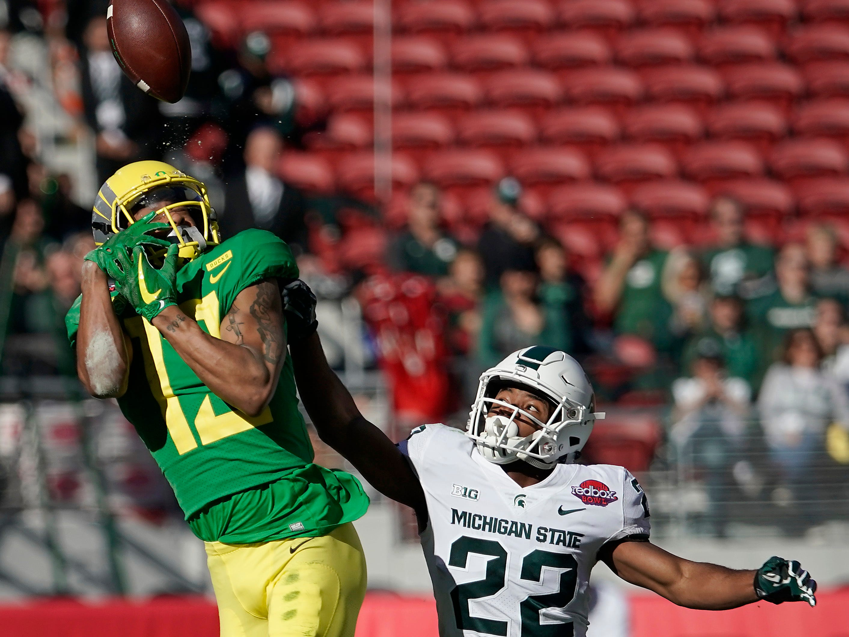 Oregon wide receiver Dillon Mitchell (13) cannot make a catch against Michigan State cornerback Josiah Scott (22) during the first half of the Redbox Bowl NCAA college football game Monday, Dec. 31, 2018, in Santa Clara, Calif.
