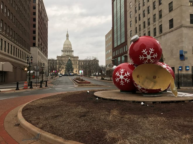 Police said a dark colored sedan struck this holiday ornament sculpture at Washington Square and Michigan Avenue at 1:40 a.m. Sunday and continued north on Washington.