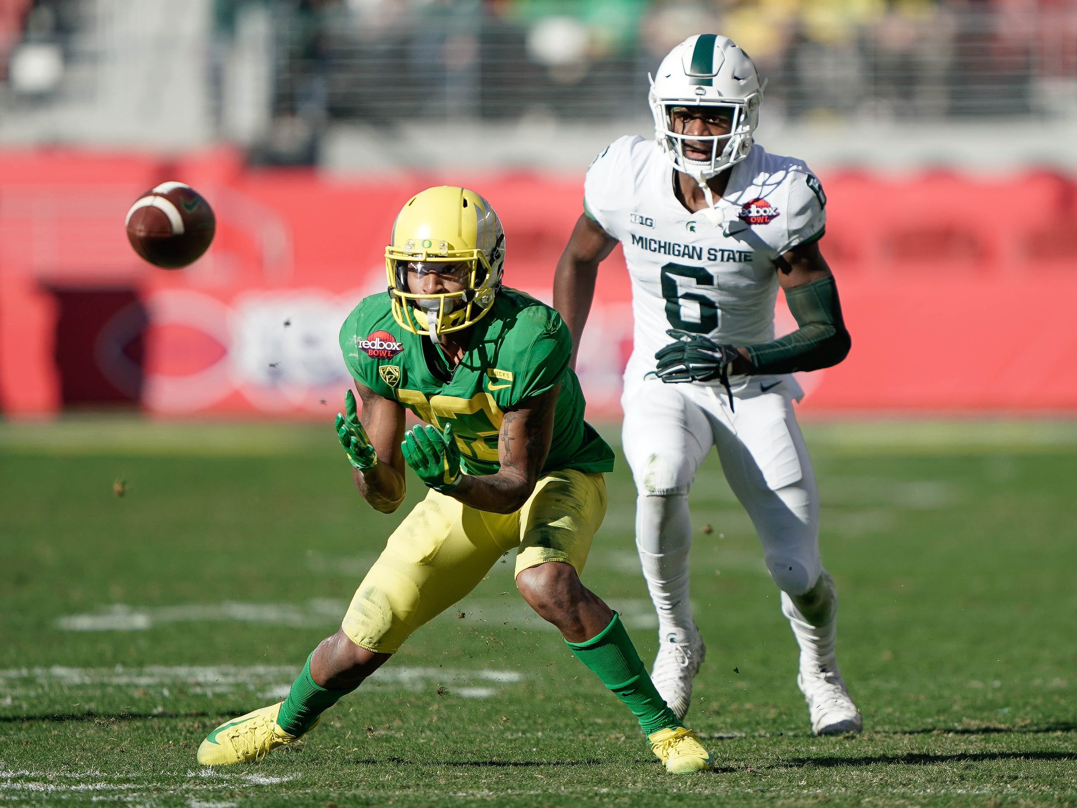 Oregon Ducks wide receiver Dillon Mitchell (13) prepares to catch the ball against Michigan State Spartans safety David Dowell (6) during the second quarter at Levi's Stadium.