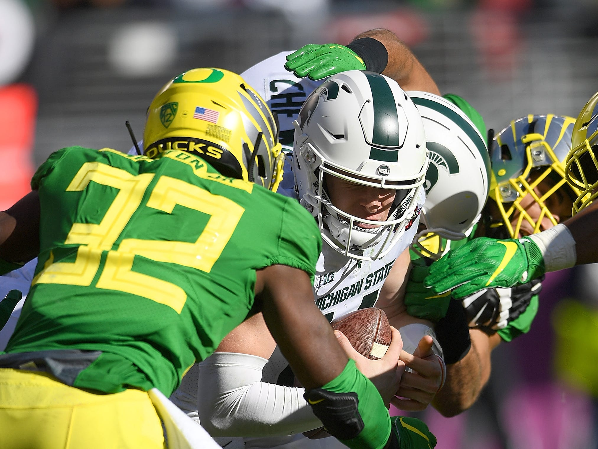 Brian Lewerke #14 of the Michigan State Spartans gets sacked by La'Mar Winston Jr. #32 of the Oregon Ducks during the first half of the Redbox Bowl at Levi's Stadium on December 31, 2018 in Santa Clara, California.