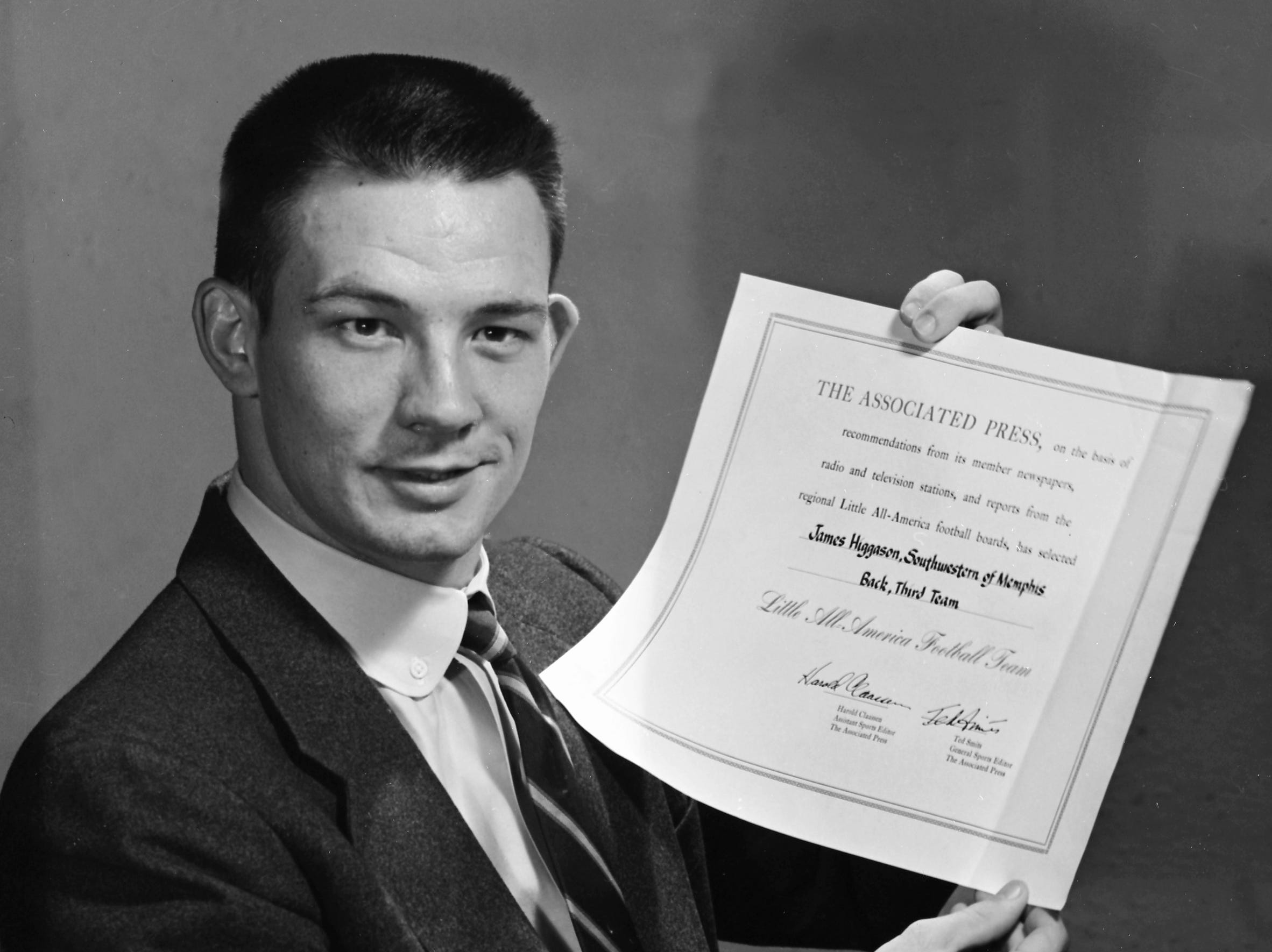 Jimmy Higgason, Southwestern halfback, who made the Associated Press' third team Little All-American squad, proudly displays the certificate he received in January 1956.  Higgason's home is in Pine Bluff, AR.